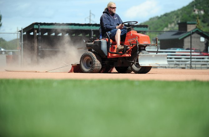 City of Steamboat Springs Parks, Open Space and Recreation maintenance worker John Green drags Klumker Field Wednesday afternoon. The parks and recreation commission will hold a work session next week to learn about parks and recreation taxing districts.