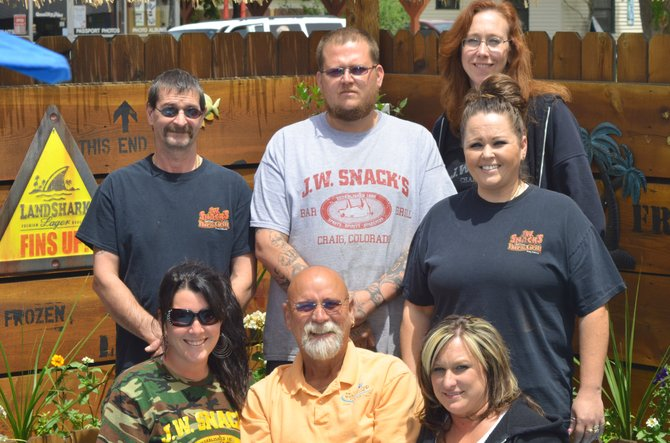 The staff of JW Snack's Bar & Grill gathers around owner Danny Griffith in the restaurant's patio section. JW Snack's received several Best of Moffat County awards recently, including Best Bar, Best Outdoor Dining, Best WIngs and Best Place to Watch the Game.