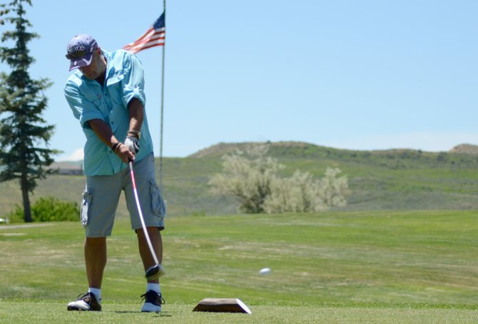 Dave Higgins hits his tee shot at the 10th hole at Yampa Valley Golf Course Friday afternoon. Higgins, along with teammates Dallas Dearden, Jason Atkins and Chad Bowdre were playing in the 14th The Memorial Hospital Foundation golf tournament. A full field of 25 teams participated in the four-person scramble tournament.