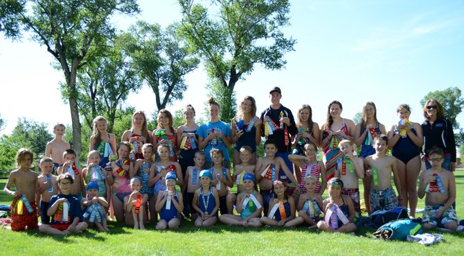 The Craig Sea Sharks won hundreds of ribbons for their high finishes Saturday and Sunday at the ABC Open in Craig. Micah Espinosa, Chris Kling, Molly Neton and Kelsey McDiffett also won trophies for being the high point-scorers in their age groups.