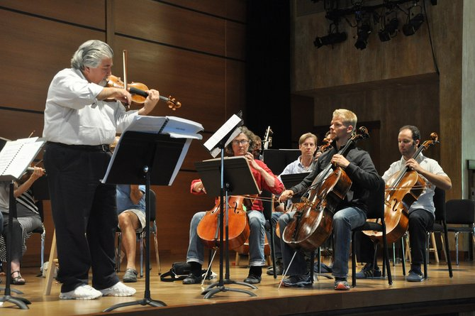 Andres Cardenes leads a rehearsal for an upcoming classical concert in the Strings Musical Festival.