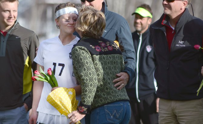 Steamboat Springs High School graduate Maddie Ruppel receives a kiss on the cheek from her mother, Jill, during the girls soccer team's senior night April 17. Ruppel was accepted into three United States military academies and will begin at West Point this week on a full scholarship.