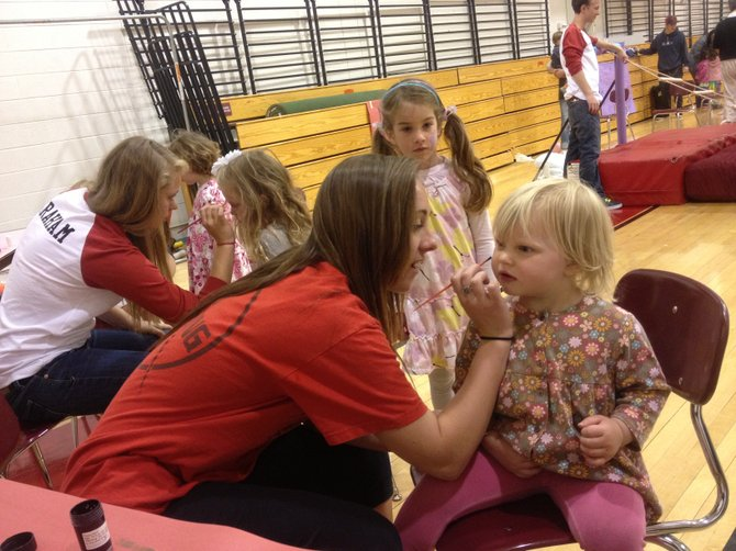 Steamboat Springs area students paint toddlers' faces at a school-sponsored activity fair.