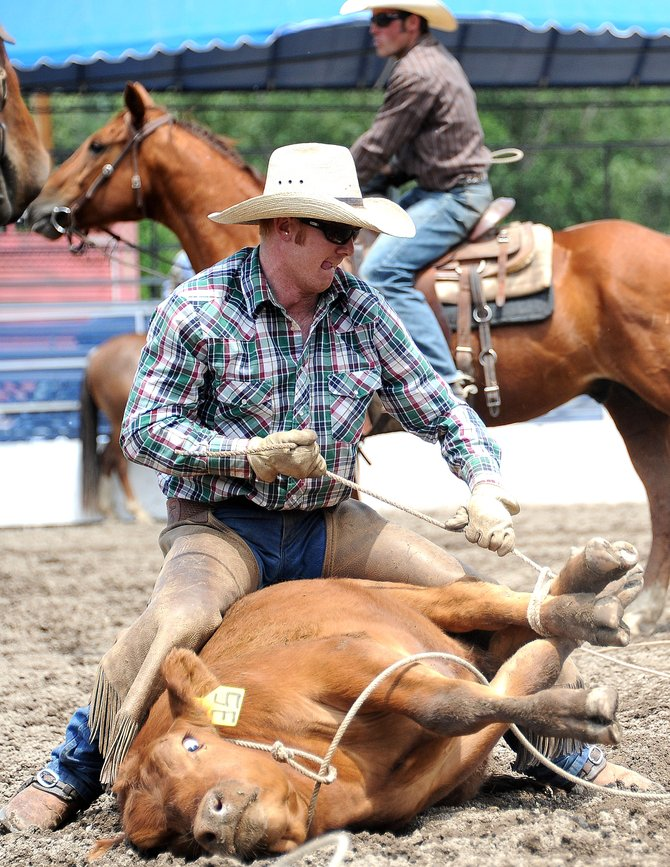 Whit Gates ties up a steer Sunday during as past Ranch Rodeo in Steamboat Springs. The Ranch Rodeo is back at 6:30 p.m. Wednesday at the Brent Romick Rodeo Arena.