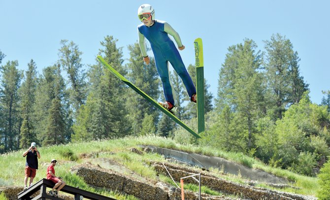 Davis Petersen takes flight off the HS75 jump hill Wednesday morning while training for this week's July Fourth Ski Jumping Extravaganza at Howelsen Hill. More than 70 jumpers from around the country will be in town to take part in the events, which begin Thursday and will continue Friday.