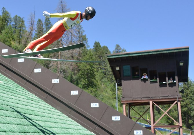 Taylor Fletcher flies over the judges' stand Thursday during the first day of competition in the Ski Jumping Extravaganza event in Steamboat Springs. The event continues Friday with a roller ski race downtown, then more jumping at Howelsen Hill.