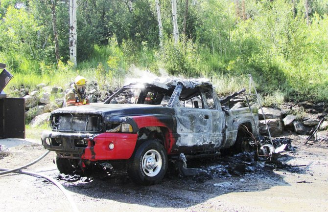 No one was hurt Wednesday morning when a camper and truck caught fire at a parking area near the Stagecoach Reservoir dam.