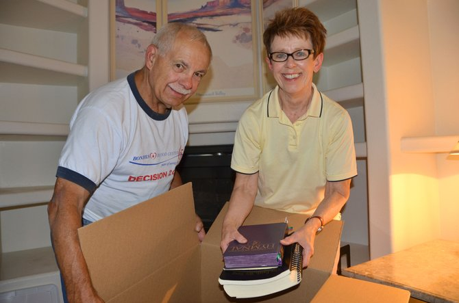 Husband and wife Phillip and Karen Gibson pack up hymnals and other religious texts along with other items in their Oak Street home. The couple, co-pastors of Friendship United Methodist Church, will leave Craig this week to move to Ohio and undertake leadership for churches in Conesville and New Moscow.