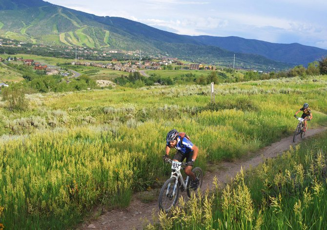 Riders head down the trail above Steamboat Springs on Wednesday. The Town Challenge Mountain Bike Series returned to Emerald Mountain for its third race of the summer.