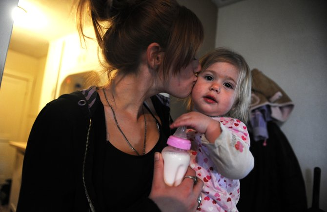 Sixteen-month-old Tazia Atencio is pictured in 2011 with her teen mother Alexis Parker, 17, in their one-room apartment in Walsenburg. Colorado improved from having the 29th-lowest teenage birth rate in 2008 to having the 19th-lowest in 2012, according to the governor's office.