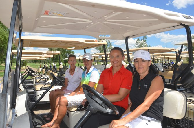 From left, golfers Susan Utzinger, Jamie Eckroth, Heather Cannon and Lani Cleverly kick back in carts Sunday afternoon following the Ladies Silver Bullet Classic at Yampa Valley Golf Course. About 65 women played in the two-day tournament.