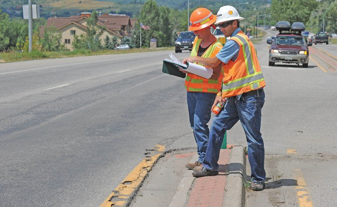 Eric Marsh, operations manager for Connell Resources, and Colorado Department of Transportation project manager Debbie McLain work on a preliminary survey for highway improvements on U.S. Highway 40 that will begin this summer. The $6 million resurfacing project includes traffic signal upgrades and ADA improvements extending from the Elk River Road intersection to 13th Street and then from Third Street to Walton Creek Road.