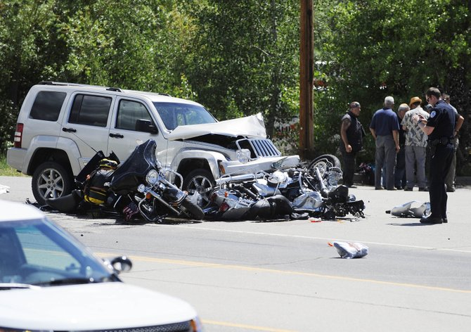 Police investigate the July 2, 2013, accident that killed German motorcyclist Fels Bernhard. Routt County Judge James Garrecht on Monday determined Steamboat Springs resident Scott Penfold was guilty of careless driving resulting in death.