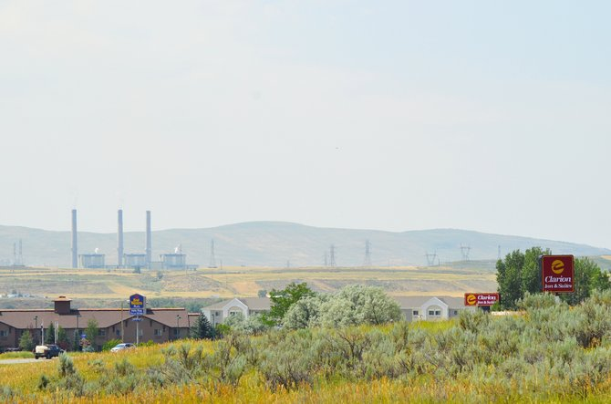 Craig Station sits in the background of hotels in Craig. The coal-fired power plant didn't conduct its spring maintenance, which ultimately hurt Moffat County's lodging industry's first-quarter numbers.