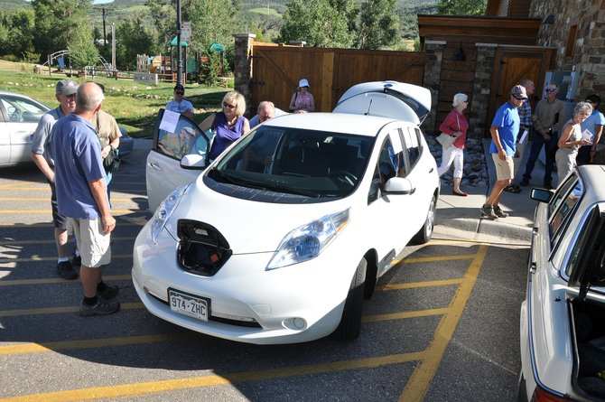 Attendees of a green car show check out Jeff Troeger's electric Nissan Leaf on Tuesday night at the Steamboat Springs Community Center. The car show was followed by a panel discussion on the future of transportation in Colorado.