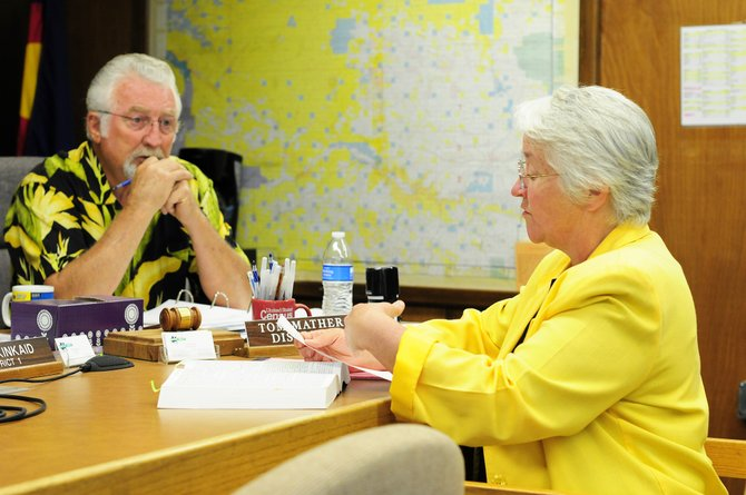 Moffat County Commissioner Tom Mathers listens to county attorney Rebecca Tyree explain the ballot language for cultivation marijuana facilities within county limits.