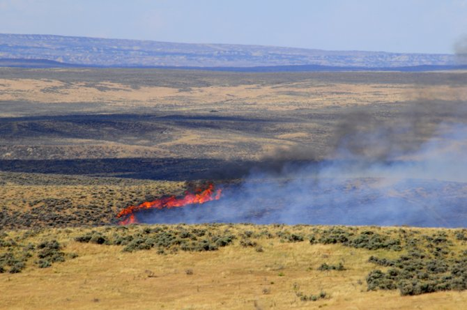 The northeast edge of the Alkali Fire burns 5,000 acres north of Moffat County Roads 8 and 7.