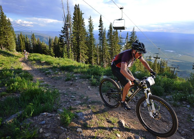 Mountain bikers are a common sight in Steamboat Springs, a town full of outdoor adventures. Steamboat Springs was recently nominated by Outside Magazine as one of the towns in its Best Towns of 2016 contest and it's up to readers to decide the winner. (In this photo: Tony Dickson pedals near the top of Mount Werner on Wednesday during the Storm Peak Hill Climb)
