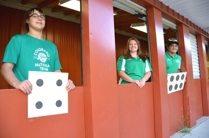 From left, Moffat County shooters Hunter Rummel, 16, Dakota Lee, 18, and Dylan Villa, 18, display the windows and targets of the shooting range at Bears Ears Sportsman Club. The three of them, as well as Travis Walsh, competed and finished highly in the National 4-H Shooting Sports Invitational, which included gun and archery events.