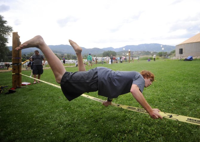 Steamboat Springs 16-year-old Parker Temple tries out the new slackline park Saturday at Howelsen Hill.