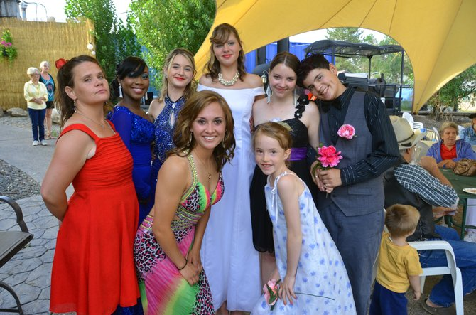 Many of the participants of the LOVEMI Thrift Way Fashion Show display their formalwear following the event Saturday night. Back row, from left: Jazmine Hanna, Laura Leigh Ellis, Justyne Anthony, Erica Davidson and Glenden Reuer. Front row: Laura Marie Skufca, Ripley Bellio and Adisen Reuer. The show included clothing from many local and regional secondhand stores.