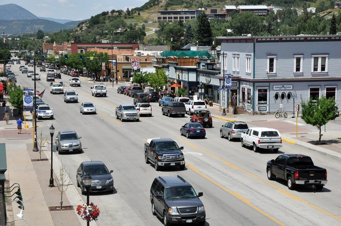 Traffic moves through downtown Steamboat Springs on Monday afternoon. The city is hosting a public forum on downtown parking Tuesday night as it continues to look into possible changes to the parking system.