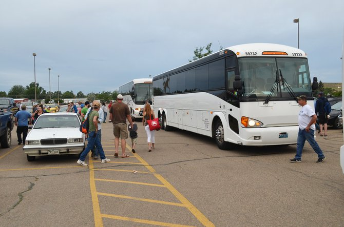 Dozens of people loaded five buses in the K-Mart parking lot in Craig on Tuesday morning. The buses are headed to Denver for a coal rally that will take place near the state Capitol. The Environmental Protection Agency is holding carbon emission hearings at its Denver offices Tuesday and Wednesday.