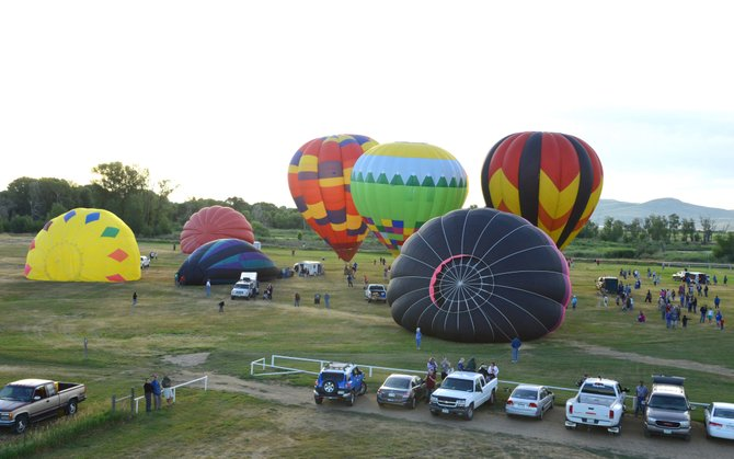Balloon crews begin preparations leading up to the fourth annual Moffat County Hot Air Balloon Festival in 2013. This year's event takes place starting at 6:30 a.m. Friday, Saturday and Sunday at Loudy-Simpson Park.