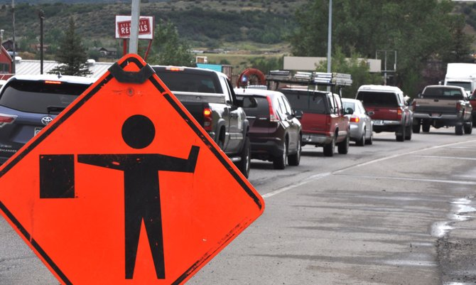 Traffic backs up on U.S. Highway 40 west of downtown Steamboat Springs on Tuesday afternoon due to utility work along the road. Traffic is expected to get worse in the area Thursday when a major road construction project kicks off on both sides of the city.