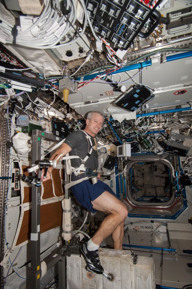 Steve Swanson works out on the Cycle Ergometer with Vibration Isolation System (CEVIS) in the U.S. lab Destiny of the International Space Station. Swanson will run in the Wild West Relay using a treadmill on the International Space Station.