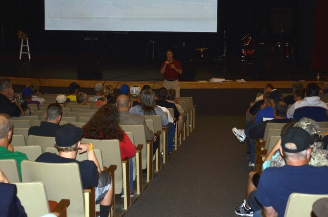 Moffat County High School's new Athletics and Activities Director Mike Mitchell addresses players and parents Monday night in the MCHS auditorium. Mitchell and new head football coach Keith Gille met with the community to introduce themselves before the fall sports season and the new school year.