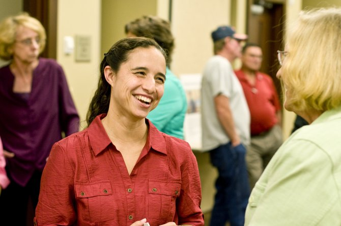 Dr. X. Alexis Driggs, new general surgeon at The Memorial Hospital, talks with Gisela Garrison, director at the Northwest Colorado Visiting Nurse Association, at the hospital's meet-and-greet Tuesday evening.