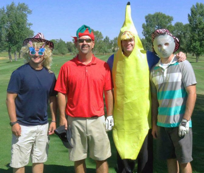 From left, Eric Hamilton, Shane Camilletti, Kyle Sorensen and Joe Padon show their goofy side during the 2013 Bear River Young Life Charity Golf Tournament at Yampa Valley Golf Course. This year's event takes place Saturday.