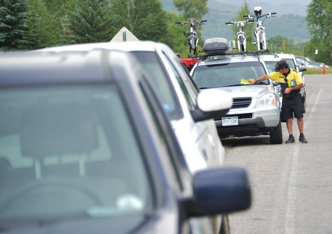 Steamboat Springs Police Department community service officer Scott Shaffer issues a parking citation on Mount Werner Road last month. After hearing the results of the latest downtown parking study, several Steamboat Springs City Council members are calling for an increase in parking enforcement.