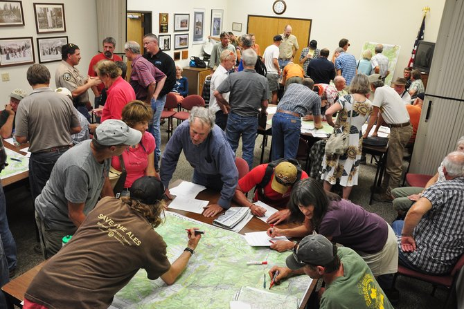 Cyclists, hikers, offroad enthusiasts and a crowd of other trail users draw their ideas for new trails on large maps at a planning meeting in Steamboat Springs. The U.S. Forest Service will use all the feedback to help develop a new master plan for local trails in the Hahn's Peak-Bears Ears Ranger District.