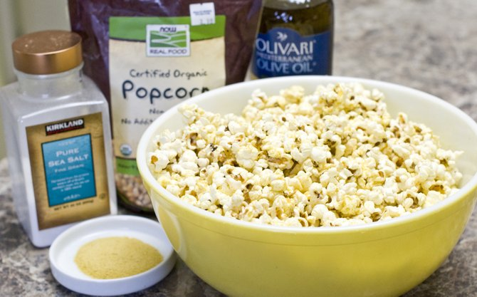 Making your own popcorn is fun and easy. Try this recipe with olive oil, nutritional yeast and sea salt for a nutritious snack.