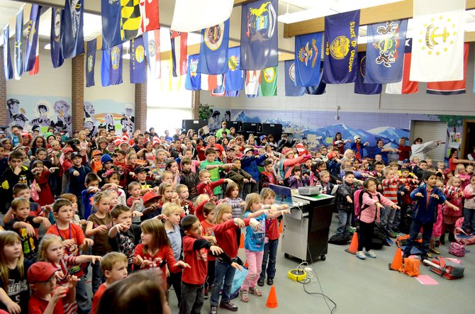 "The students of Sandrock Elementary School perform a dance to the song ""Monster Mash"" as part of preparation for TCAP testing in March. TCAP results for 2014 were recently released by Colorado Department of Education."