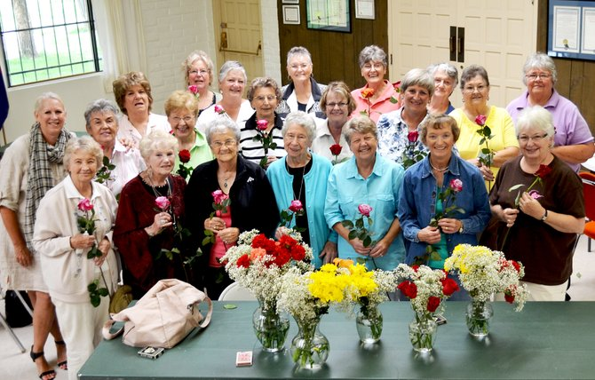 Women gather at Coffee and a Conversation on Tuesday morning held at the American Legion in Shadow Mountain. It was the first big event hosted the Senior Social Center. The Flower Mine in Craig donated flowers to the event.