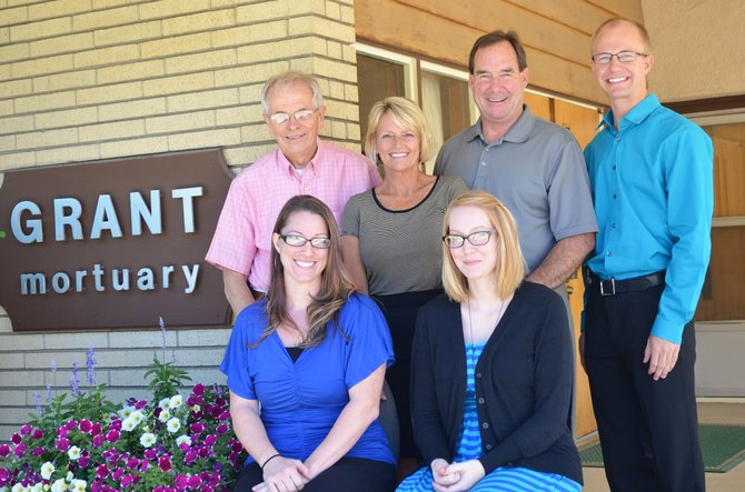 Grant Mortuary was sold to the Allnutt family. Owen Grant, back left, stands next to Suzanne and Rick Allnutt, and Jesse Arthurs who is the new manager of the business. Ellen Brockett, bottom left, and Sunny White will remain working for the mortuary.