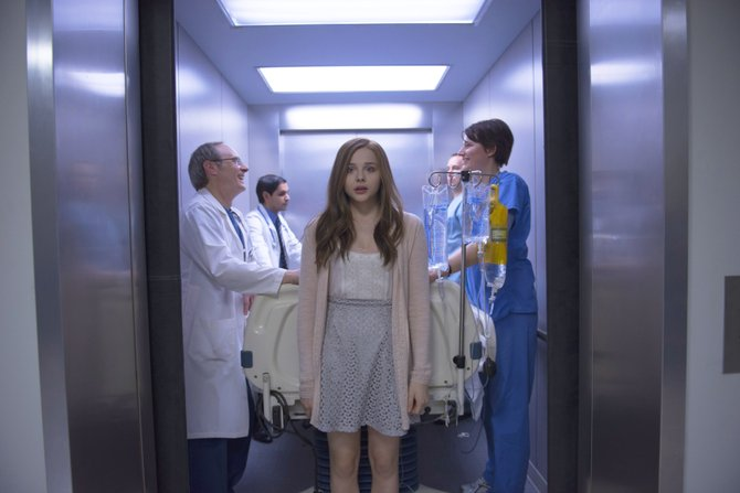 "Mia (Chloë Grace Moretz) is forced to accompany a group of doctors to surgery in ""If I Stay."" The movie is about a teenage cellist who has an out-of-body experience after a car wreck and must choose if she wants to live."