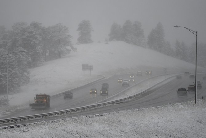 Drivers face winter driving conditions as traffic makes its way along Interstate 70 near Genesee in October 2013.
