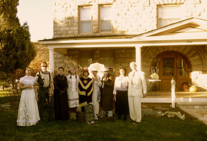 During the 2013 Haunted Tours, storytellers stand in front of the Crawford mansion. The haunted tours for this year will take place at 4, 5:30, 7 and 8:30 p.m. Saturday.