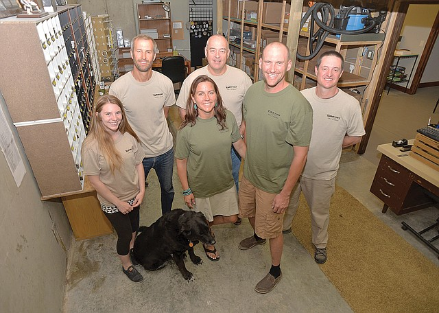 Tight grip on the market: The TALON staff at their headquarters in Copper Ridge.