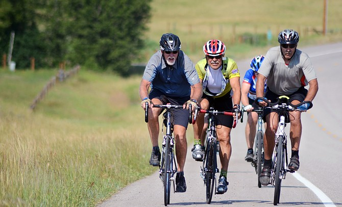 A group of riders heads up Colorado Highway 131 just outside Steamboat Springs during the 2014 Tour de Steamboat. The event raised a record $72,000 for local causes, but organizers hope to surpass that mark during the 2015 charity ride.
