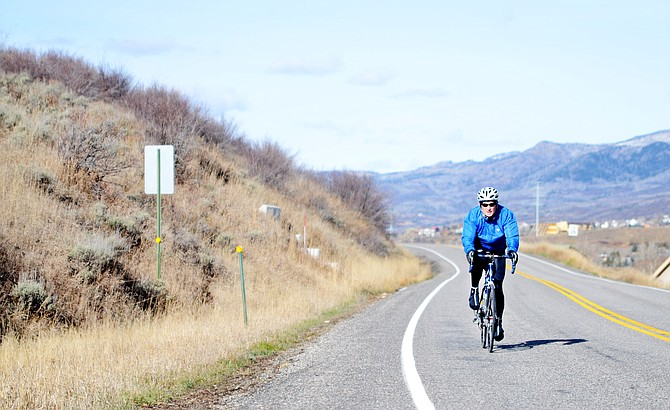 Steamboat Springs resident Bob Chiampia, 54, coasts through his regular ride along River Road toward Colorado Highway 131 on Wednesday afternoon. Chiampia and other cyclists are taking advantage of a bit of a cycling season extension with another week of sunny skies in the forecast.