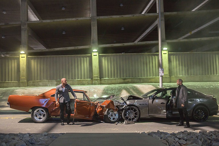 """Foes Dominic Toretto (Vin Diesel) and Deckard Shaw (Jason Statham) stare each other down in """"Furious 7."""" The movie is a continuation about the worldwide exploits of a crew of skilled drivers."""