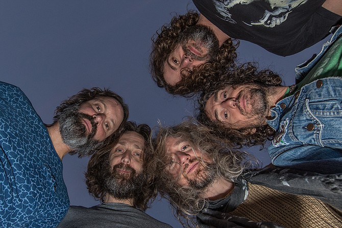 "The Chris Robinson Brotherhood has developed an identity as a self-defined ""farm to table psychedelic rock band"" comprised of members Chris Robinson on vocals and guitar, Neal Casal on guitar and vocals, Adam Macdougall on keys, Tony Leone on drums and Mark Dutton on bass."