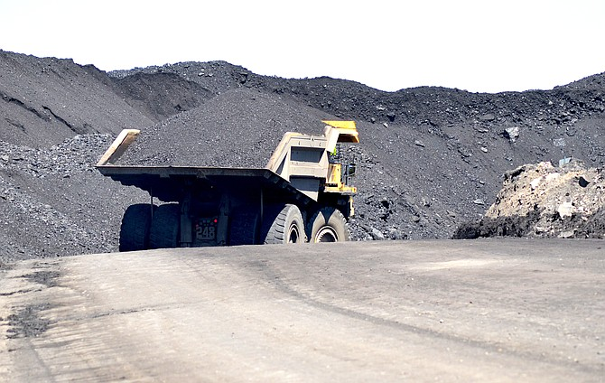 A haul truck moves a large quantity of coal to a coal stock pile within Colowyo Coal Company in Meeker.