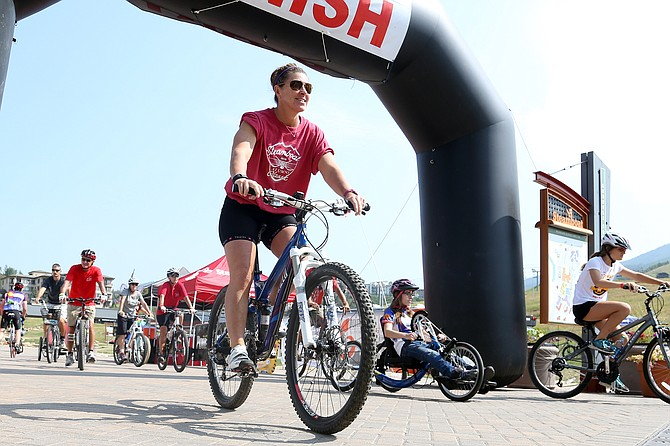 Cyclists of all types get their five-mile bike ride underway Saturday at the base of Steamboat Ski Area. The ride was part of the fifth annual STARS Biking the Boat charity ride, which raises money for Steamboat Adaptive Recreational Sports.
