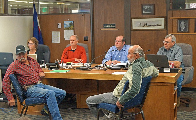 Moffat County Commissioners John Kinkaid, Frank Moe and Chuck Grobe discuss Leafy Spurge, an invasive weed, with Yampa Valley River System Legacy Partnership member Ben Beall and Moffat County Pest Management Manager Gary Brannan.